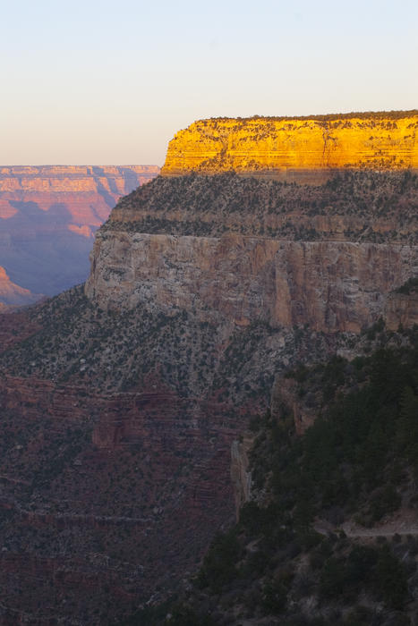 last light of the day illuminates the escarpments on the south rim of the grand canyon