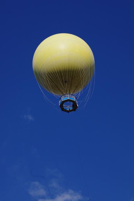 a yellow spherical tethered balloon