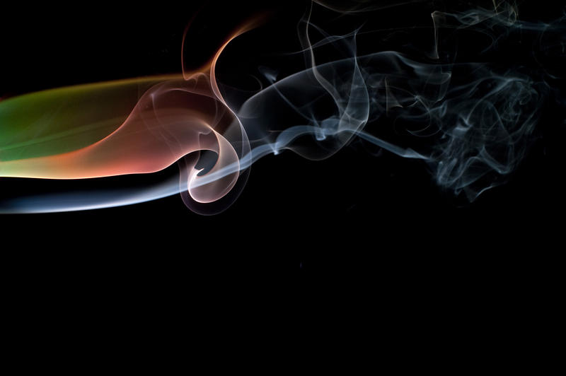 colorful abstract smoke patterns against a black background