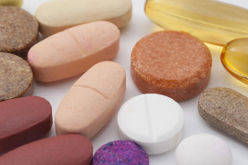 an assortment of multivitimin and supplement tablets