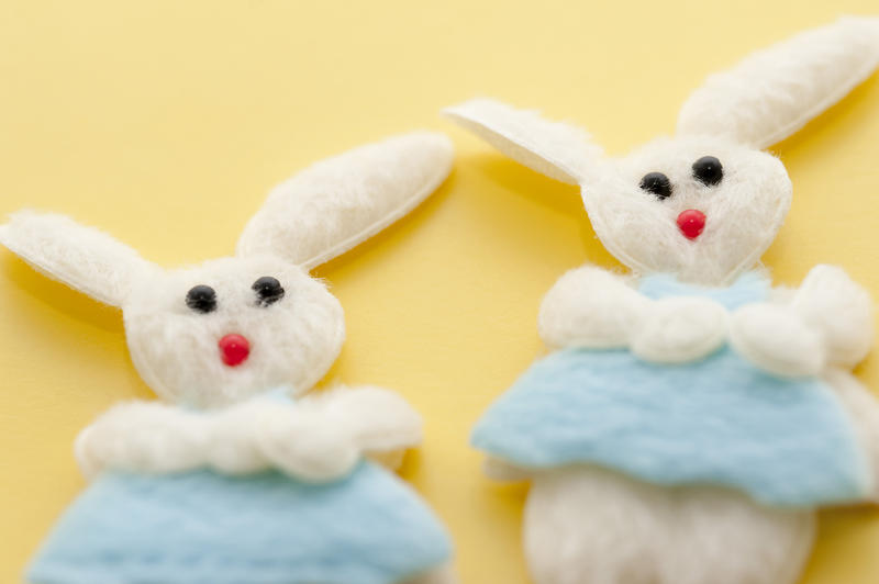 Two cute decorative needlework Easter Boy Bunnies in soft felt with blue clothing