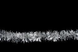 4707   christmas tinsel on black