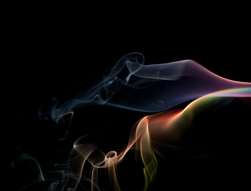 a colorful cloud of smoke vapour on black