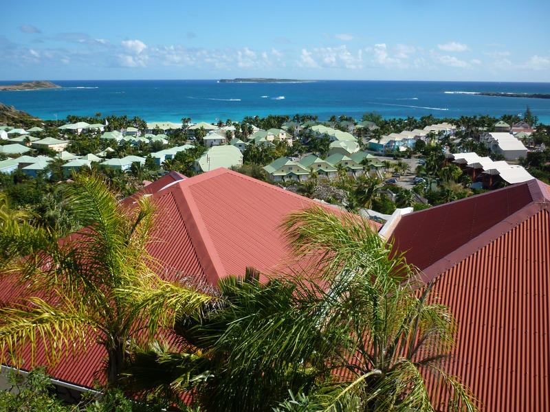 a view out to sea over rooftops on the island of st maarten