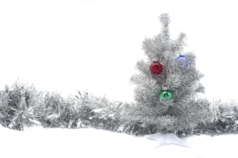 a silver colored artifical chritmas tree and a line of silver tinsel