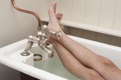 6887   Man enjoying a hot relaxing bath