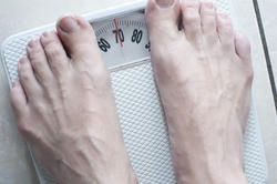 6888   Man standing barefoot on a bathroom scale