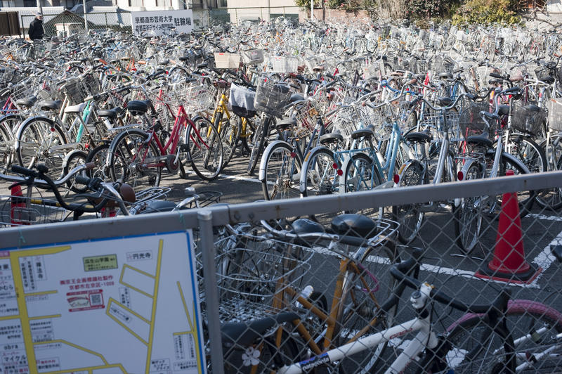 hundereds of cycles in a japanese bicycle parking area