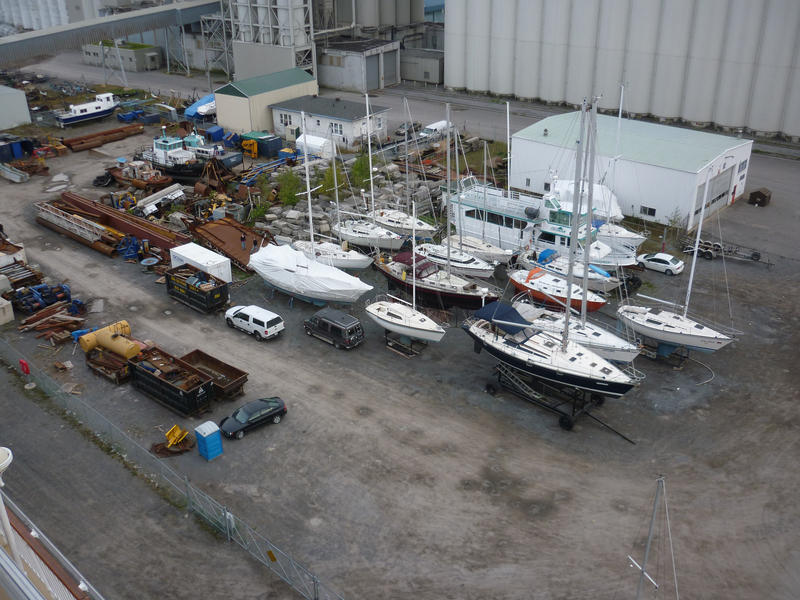 High angle view of small pleasure yachts on trailers in a boatyard taken out of the water for repairs or for the winter season