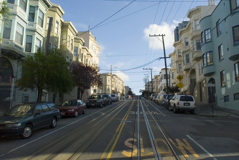 Economic Concept: A slow climb. A ride up a steep hill on a san francisco cable car