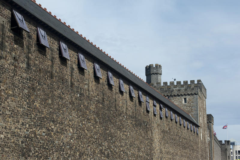 Exterior view of the stonework and crenellated tower on the walls at Cardiff Castle in Wales