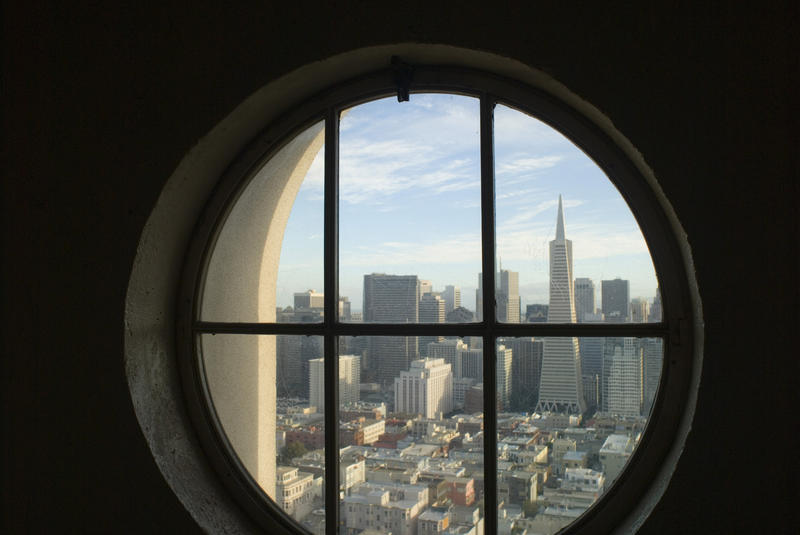 looking out of the coit tower towards downtown san francisco