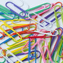 5408   Scattered colourful paperclips