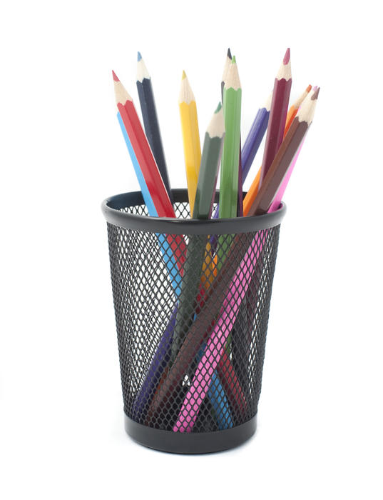 Colouring pencils in a metal container desk tidy ready for colouring in, drawing or handicraft
