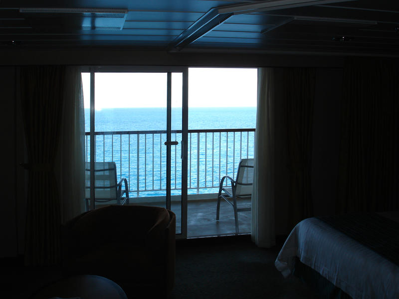 cruise ship cabin with a balcony