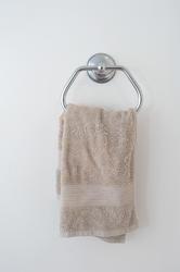 6923   Beige hand towel hanging in a bathroom