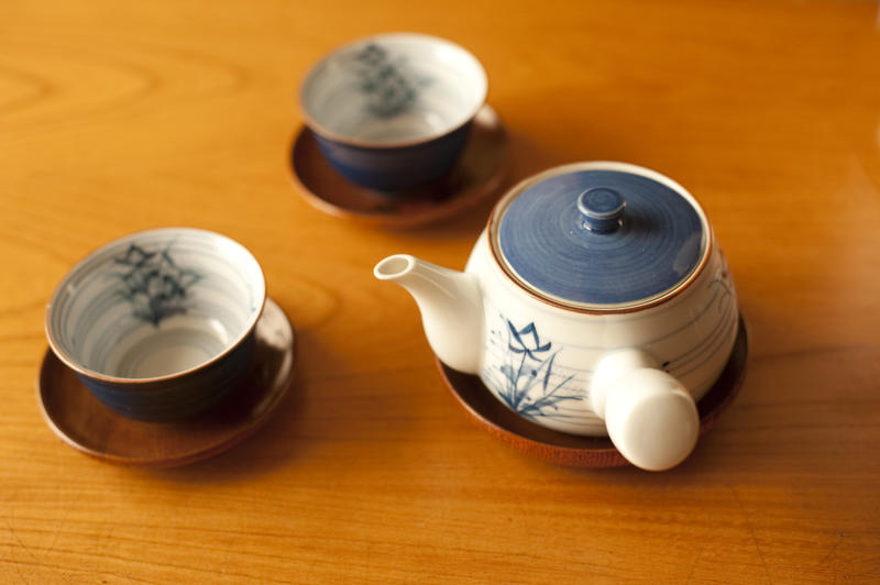 japanese teapot and cups in a wooden table