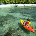 6300   Kayaker on crystal clear tropical water