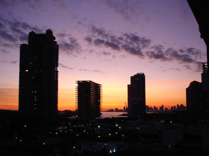 Beautiful vivid Miami sunset with tall skyscrapers and hotels silhouetted against the dramatic sky