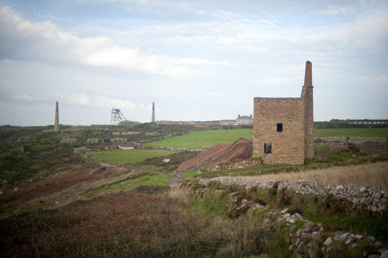 Botallack mining landscape near St Just with the ruins of an engine house with headgear and chimneys in the background now part of the Cornwall and West Devon Mining Landscape World Heritage site