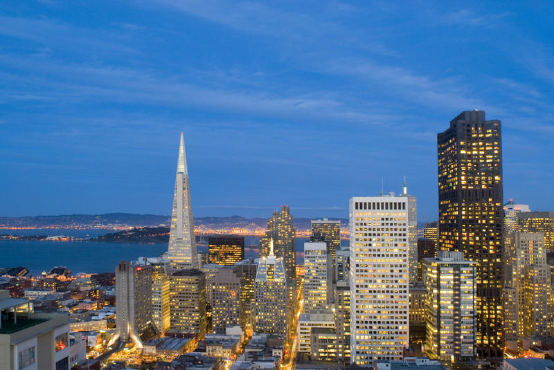 last moments of daylight illuminate a spectacular view of san francisco downtown office buildings