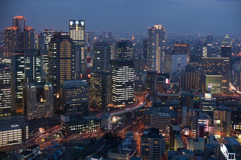 brightly lit buildings of Osaka at night, Japan