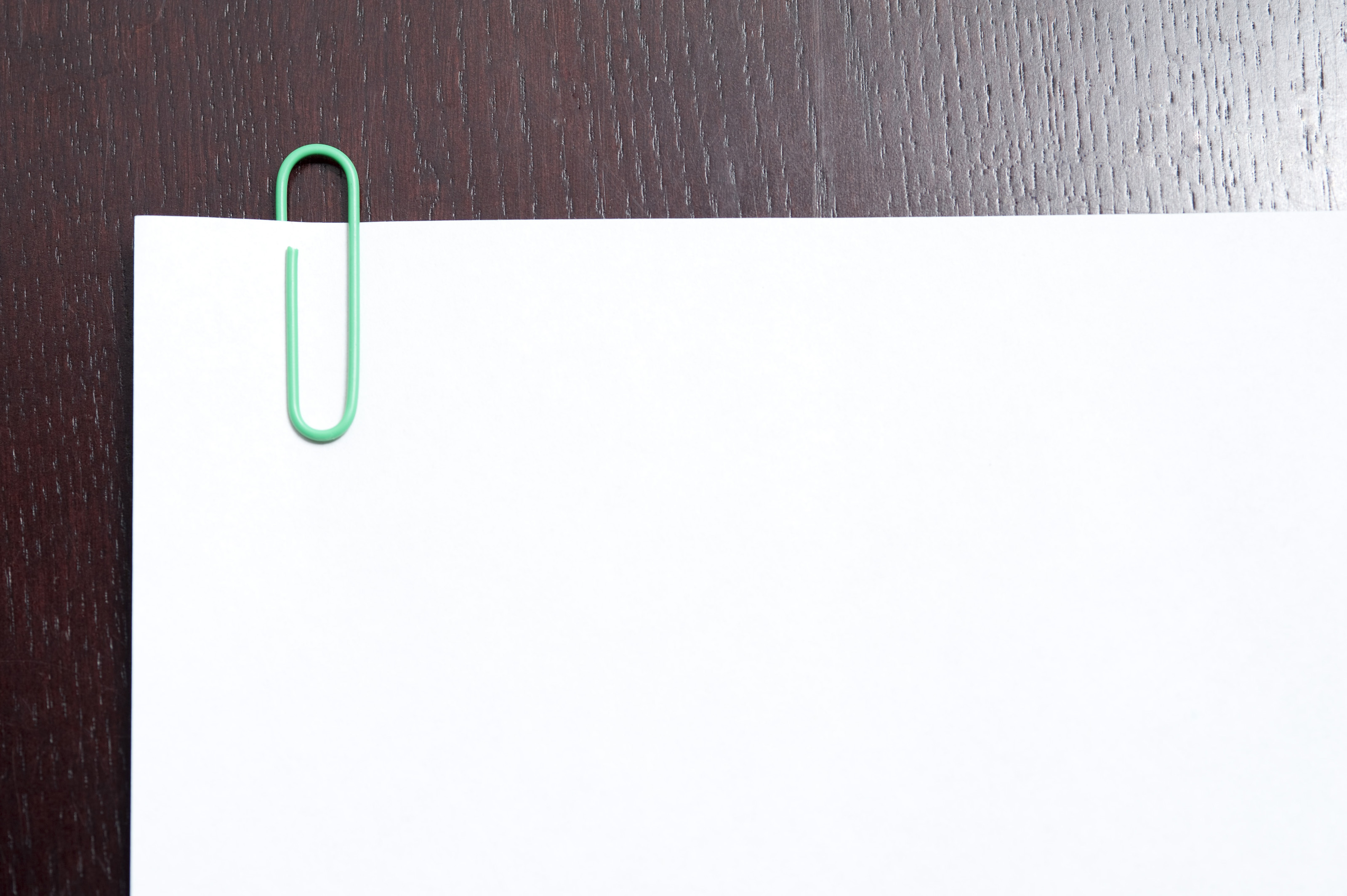 Blank Document With Several Pages Held Together With A Paper Clip Lying On  A Textured Wooden  Blank Document Free