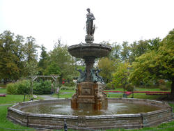 6779   Figural fountain in formal garden