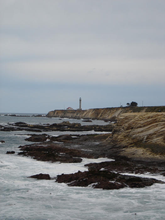 rocky coastline at point arena with the lighhouse in the distance, Mendocino County, California