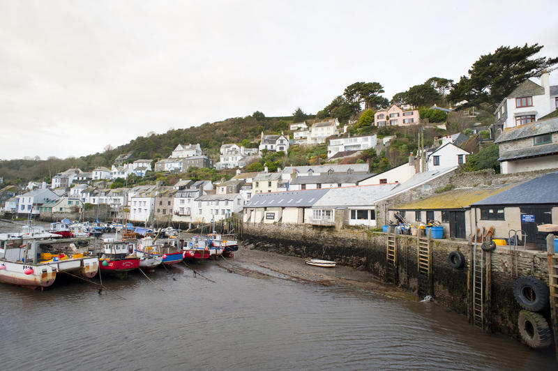 Low tide at Polperro fishing village in Cornwall, a popular tourist destination with its quaint unspoilt white washed cottages and narrow streets