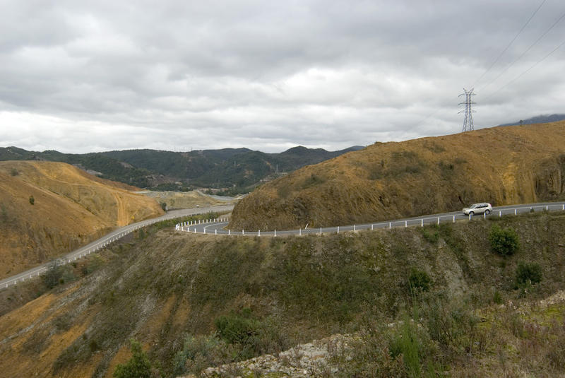 road winding its way down a mining scarred landscape towards queenstown tasmania