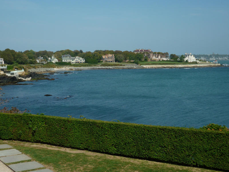 Rhode Island coastline with a view across a bay towards a row of the large waterfront mansions typical of this neighbourhood