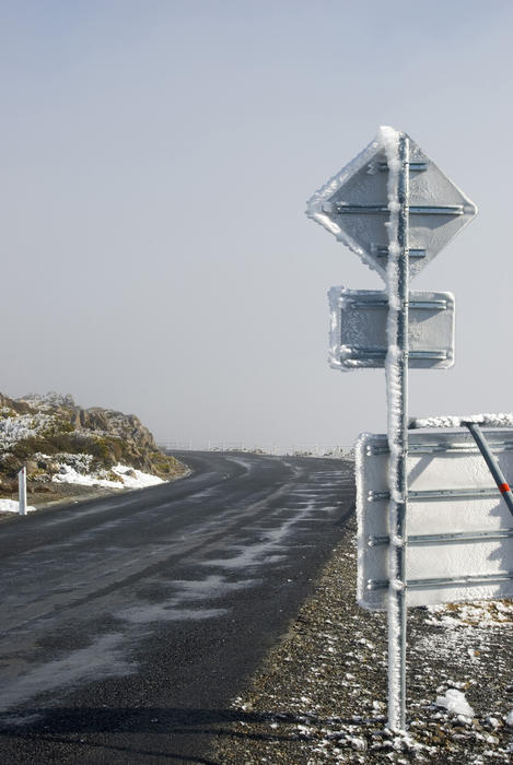 frost blown by the wind built up on a roadsign, mount wellington, tasmania