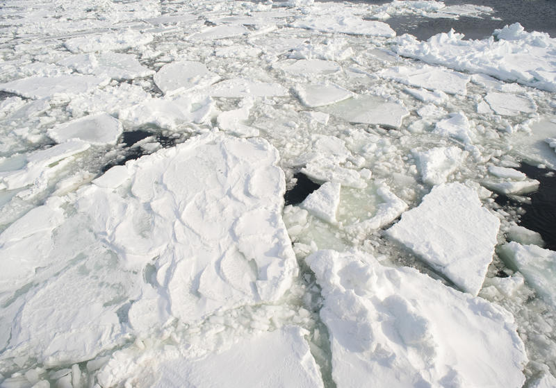 looking down onto broken drift ice sheets from an ice breaker ship