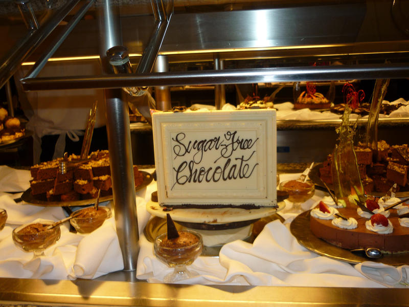 Sugar-free chcocolate products on dsiplay in a glass counter at a bakery with cakes, desserts and candy