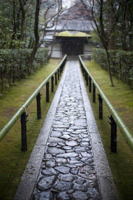 water glistening on a crazy paved path at a kyoto temple
