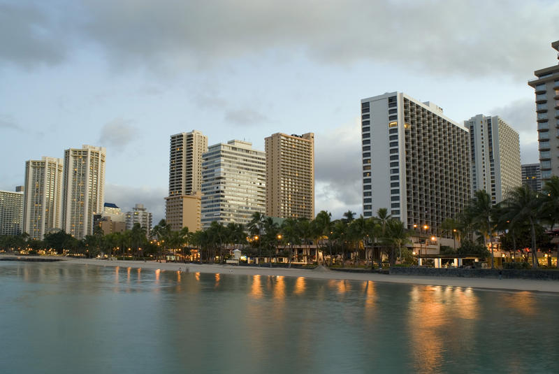 Sunrise over the many hotels on the beachfront at waikiki beach, honolulu, hawaii.