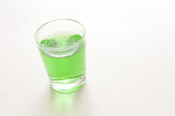10425   Glass of green absinthe liqueur