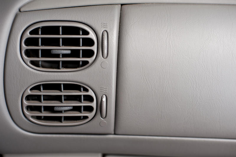 Close up Two Air Conditioner Vents System on a Gray Interior Wall of a Car