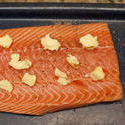 10602   Slice of Baked Salmon with Butter on Top on a Tray