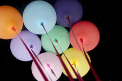 10590   Colorful party balloons on a black background