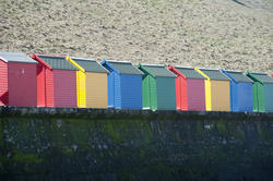 7955   Colourful beach huts and Whitby sands