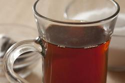 11594   Glass mug of hot black tea