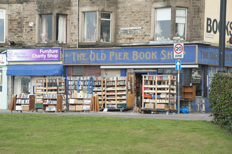 The Old Pier Bookshop in Morcambe Lancashire with portable shelving laden with stock on display outside