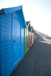 8060   Row of brightly coloured beach huts