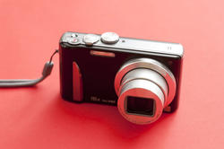 10670   Digital Camera Isolated on Red Background