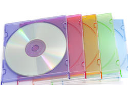 11095   Pile of Colorful CD Cases on White Background