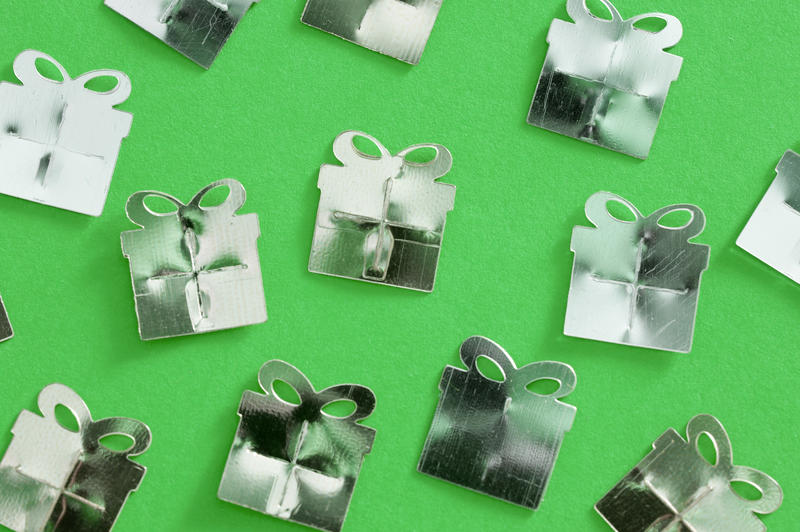 randomly arranged party of festive present shapes on a green background