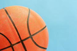 10983   Close up Basketball Ball on a Sky Blue Background