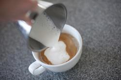 11597   Barista making cappuccino